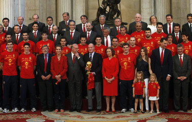 Spain's national soccer team pose with members of Spanish Royal Family during a reception at Madrid's Royal Palace