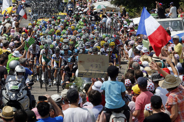 The pack of riders cycles during the 191 km fourteenth stage of the centenary Tour de France cycling race from Saint-Pourcain-Sur-Sioule to Lyon