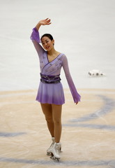 Mao Asada of team Japan waves as she competes at the ladies free skating program during China ISU Grand Prix of Figure Skating, in Beijing