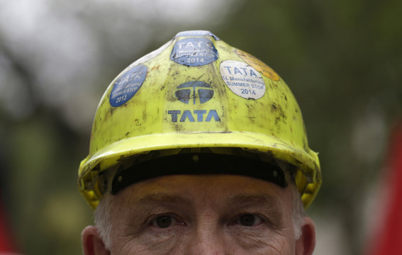A steel worker wears a hard hat during a demonstration asking for government help for the British steel industry in London