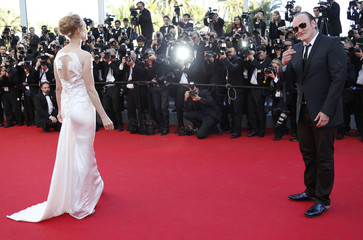 Director Quentin Tarantino and actress Uma Thurman dance on the red carpet as they arrive at the closing ceremony of the 67th Cannes Film Festival