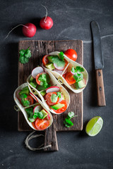 Healthy tacos with fresh vegetables and lime