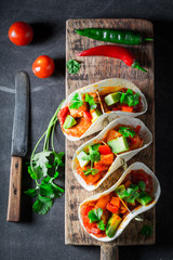 Hot tacos with avocado, lime and tomato sauce