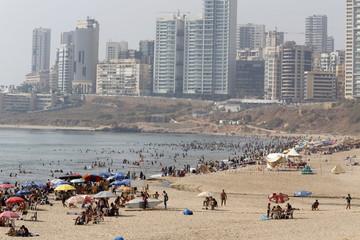 People gather at a public beach on Ramlet al Bayda seaside in Beirut