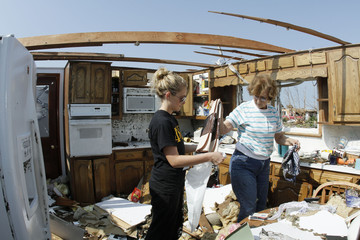 Student volunteer from Missouri Southern State University helps Wallace salvage items from her kitchen after a devastating tornado hit Joplin
