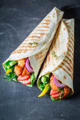 Healthy grilled tortilla with chicken, tomatoes and lettuce