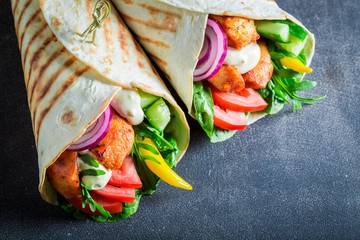 Tasty grilled tortilla with chicken, tomatoes and lettuce