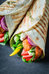Enjoy your grilled tortilla with fresh vegetables and chicken