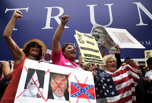 Protesters call for businesses to sever their relationships with U.S. Republican presidential candidate Donald Trump