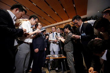 Japan's Finance Minister Taro Aso  speaks to media after a meeting of relevant cabinet ministers to discuss Britain's exit from the European Union, at Prime Minister Shinzo Abe's official residence in Tokyo, Japan