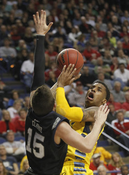 Marquette University's Blue fights to get shot under pressure from Butler University's Clarke during NCAA basketball game in Lexington