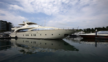 A luxury yacht is berthed at the One Degree 15 Marina Club at Sentosa Cove in Singapore