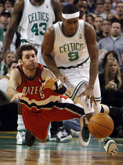 Portland Trailblazers Fernandez and Boston Celtics Rondo chase a loose ball in the fourth quarter of their NBA basketball game in Boston