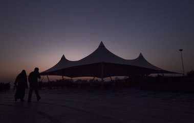A couple is silhouetted during sunset in Islamabad