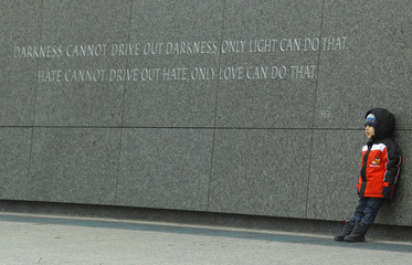 A young child poses for a picture at the Martin Luther King, Jr. Memorial in Washington