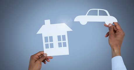 Cut out house and car in hands