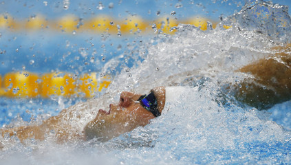 Matthew Grevers of the U.S. swims in heat 6 in the men's 100m backstroke heats during the London 2012 Olympic Games at the Aquatics Centre