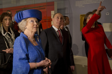 Russian President Putin and Queen Beatrix of the Netherlands listen to explanation by Director Broers as they tour the Amsterdam Hermitage museum