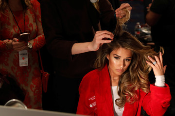 Singer Jessie James Decker prepares to take part in the American Heart Association's Go Red For Women Red Dress Fall/Winter show during New York Fashion Week in the Manhattan borough of New York