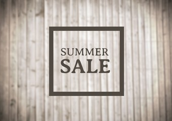 Brown summer sale graphic against blurry wood panel