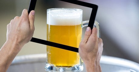 Hand taking picture of beer glass