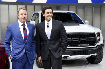 Ford and Fields of Ford speak in front of a Raptor pickup truck at the North American International Auto Show in Detroit