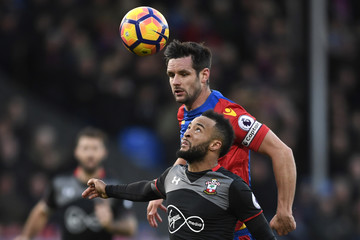 Crystal Palace's Scott Dann in action with Southampton's Nathan Redmond