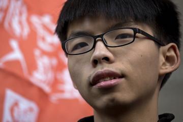 Hong Kong student leader Joshua Wong arrives at the police headquarters in Hong Kong