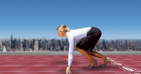 Digital image of businesswoman on starting line