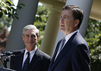 James Comey speaks alongside outgoing FBI Director Robert Mueller after being nominated by U.S. President Barack Obama to replace Mueller, in the Rose Garden of the White House in Washington