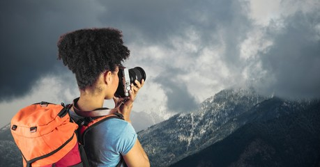 View of hipster taking pictures of mountains