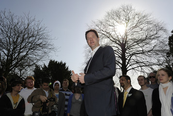Britain's Liberal Democrats leader Nick Clegg speaks to people in a park in London