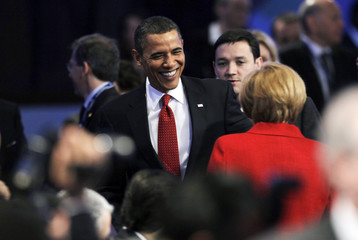 U.S. President Obama smiles at German Chancellor Merkel prior to beginning of morning plenary session at Nuclear Security Summit in Washington