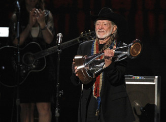 Willie Nelson accepts his lifetime achievement award at the 46th Country Music Association Awards in Nashville