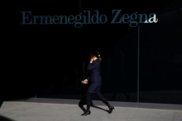 A woman walks past a boutique of the luxury fashion house Ermenegildo Zegna in Beijing