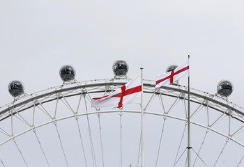 Flags depicting the St George's Cross fly near the London Eye on St George's Day in central London