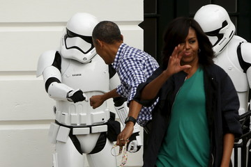 Obama fist bumps a costumed Stormtrooper from the Star Wars movies as he presides over the annual Easter Egg Roll at the White House in Washington