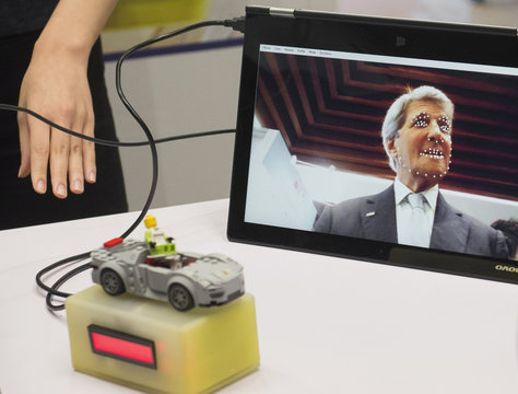 U.S. Secretary of State John Kerry appears on a tablet for a device that helps notify of a person's level of fatigue while driving a car at the National Museum in Beijing
