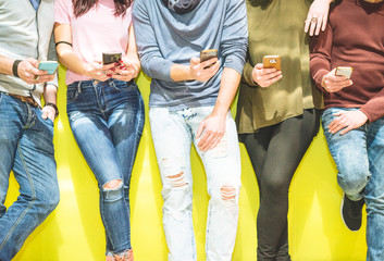 Group of friends having a social network moment watching on their mobile phone