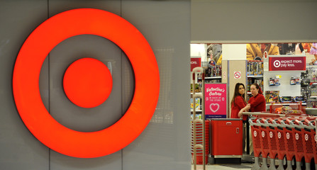 Employees work at a Target store at St. Albert