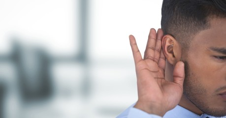Cropped image of businessman listening gossip