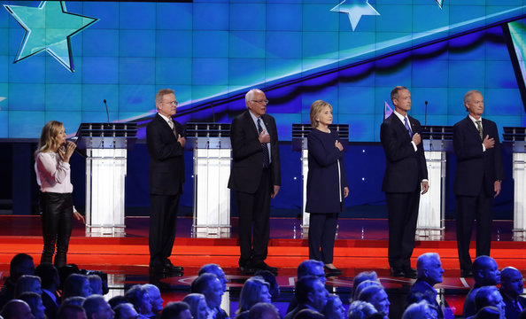 Singer Sheryl Crow sings the U.S. national anthem as she stands in front of Democratic U.S. presidential candidates at the first official Democratic candidates debate of the 2016 presidential campaign in Las Vegas