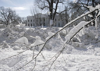 Plowed snow is seen along Pennsylvania Avenue, with the snow-covered White House in the background, in Washington