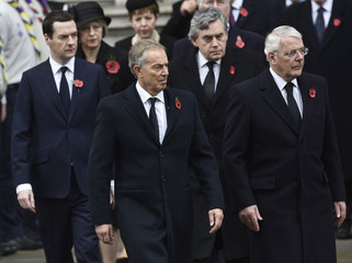 Britain's former Prime Ministers Tony Blair, John Major and Gordon Brown take part in the Remembrance Sunday ceremony at the Cenotaph in central London