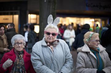 Women wearing rabbit ears take part in carnival festivities in central Bilbao