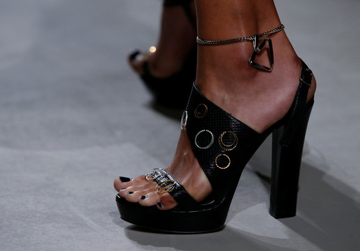 A model presents a shoes creation by American designer Adam Andrascik as part of his Spring/Summer 2017 women's ready-to-wear collection for fashion house Guy Laroche during Fashion Week in Paris