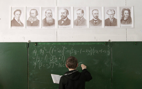 Andrey Marchenkov, 13 writes on the blackboard as he attends a mathematics lesson at a local school based in the remote Russian village of Bolshie Khutora