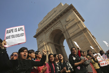 Demonstrators hold placards during a protest rally organised by various women's organisations in New Delhi