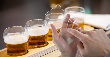 Hands taking picture of beer glasses