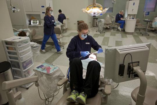 Dana Dressner has her teeth cleaned by Harper College Dental Hygiene student Katie Liberatore in Palatine